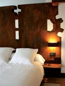 Bedroom with Rusted Wall